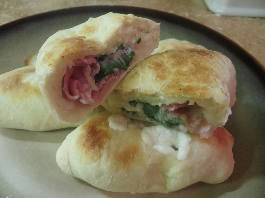 Gourmet calzone stuffed with prosciutto, goat cheese and arugula.
