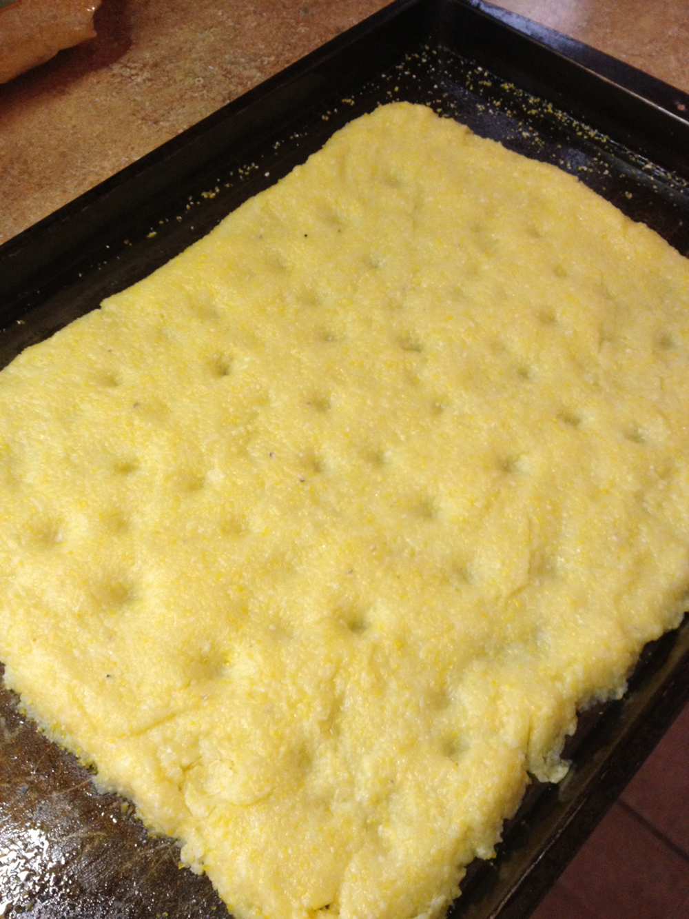 The polenta crust, shaped and ready to bake.