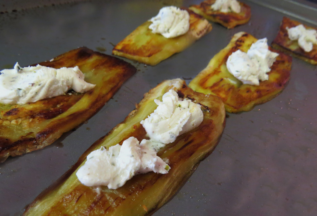 The baked eggplant topped with goat cheese.