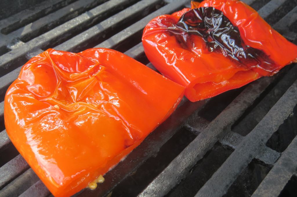 Step 3 - remove the peppers from the tray, reserving the foil covering and the oil and garlic marinade. Lay the peppers over direct high heat. Grill for 20 minutes, or until both sides of the peppers are charred and start to blister, flipping occasionally.